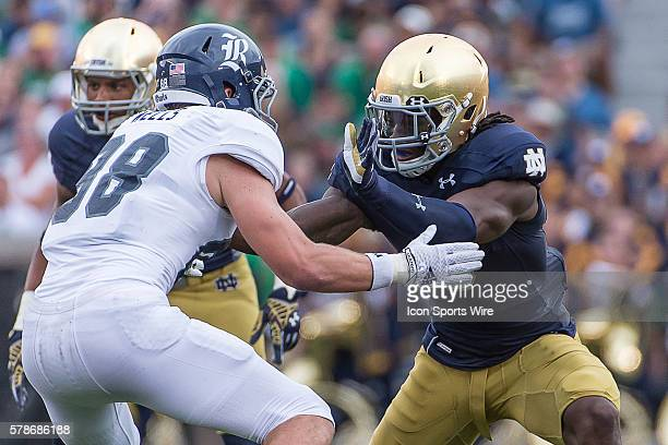 Notre Dame Fighting Irish linebacker Jaylon Smith battles with Rice Owls linebacker JD Johnson in action during a game between the Rice Owls and the...