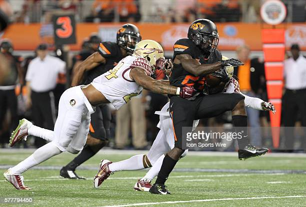 30 August 2014 Oklahoma State Cowboys running back Tyreek Hill tries to break free from Florida State Seminoles linebacker Terrance Smith during the...