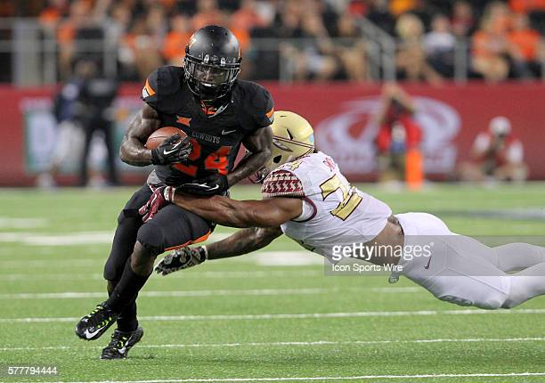 30 August 2014 Oklahoma State Cowboys running back Tyreek Hill turns up field during the Advocare Cowboys Classic college football game between the...