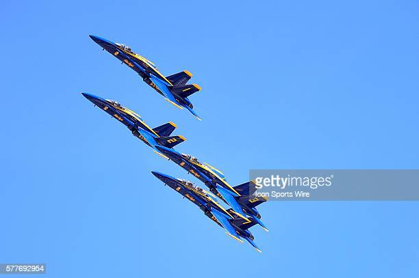 The Navy's Blue Angeles practicing for the Air and Water Show around Wrigley Field during a MLB game between the Milwaukee Brewers and the Chicago...
