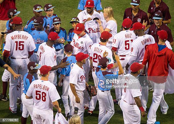 The Philadelphia Phillies pay tribute to the Taney Dragons in the baseball diamond as they give Phillies baseball jerseys to the team before a Major...