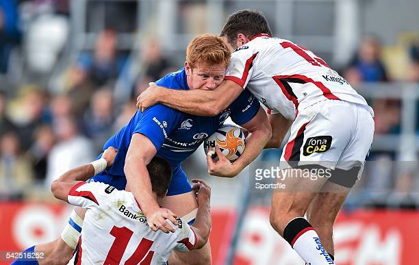 30 August 2014 Tom Denton Leinster is tackled by Michael Allen left and Jared Payne Ulster PreSeason Friendly Leinster v Ulster Tallaght Stadium...