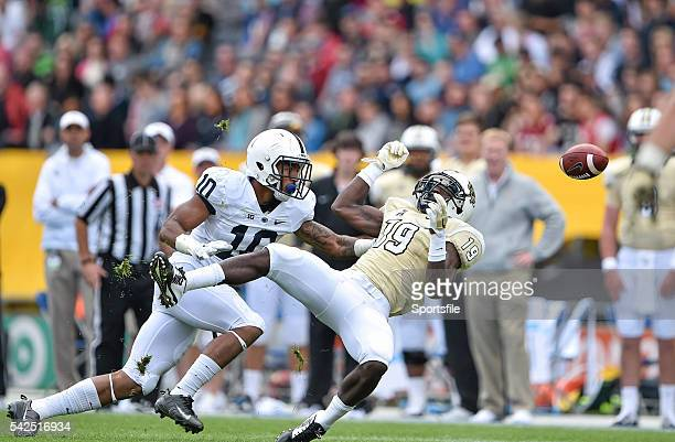 30 August 2014 University of Central Florida Wide Receiver Josh Reese fails to catch a pass under pressure from Penn State Cornerback Trevor Williams...
