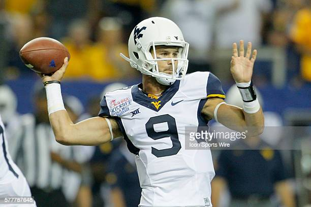 West Virginia Mountaineers quarterback Clint Trickett passes in first half action of the West Virginia v Alabama game in the ChickFilA kickoff game...