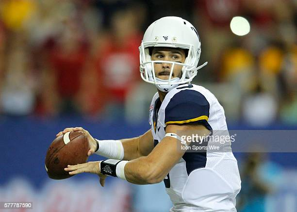 West Virginia Mountaineers quarterback Clint Trickett looks to pass in first half action of the West Virginia v Alabama game in the ChickFilA kickoff...