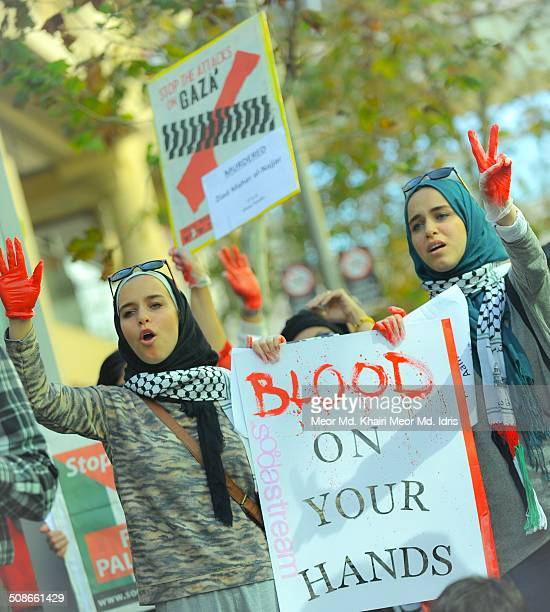 16 August 2014Members of 'Friends of Palestine West Australia' group color their hands in red symbolizing blood as they rally around Murray Street in...