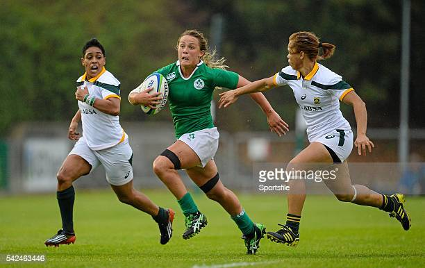 22 August 2015 Ashleigh Baxter Ireland races clear of Zenay Jordaan left and Mathrin Simmers South Africa Women's Sevens Rugby Tournament Pool C...