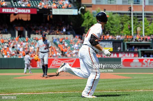 Baltimore Orioles first baseman Chris Davis rounds the bases after hitting a solo home run against Detroit Tigers starting pitcher Daniel Norris at...