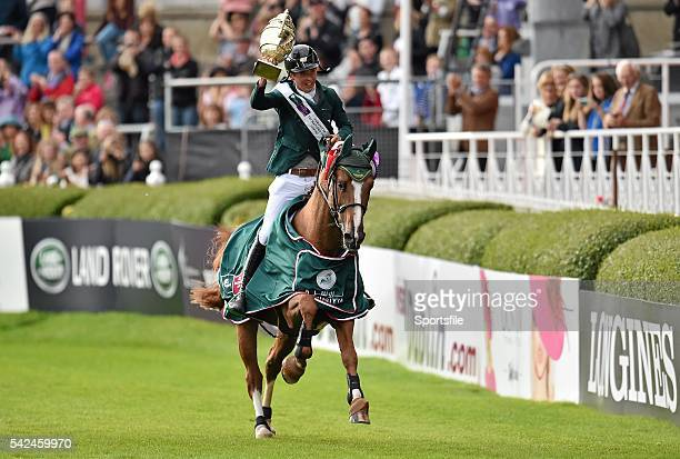 7 August 2015 Bertram Allen Ireland celebrates on Romanov with the Agha Khan Cup during a lap of honour after Ireland won the Furusiyya FEI Nations...