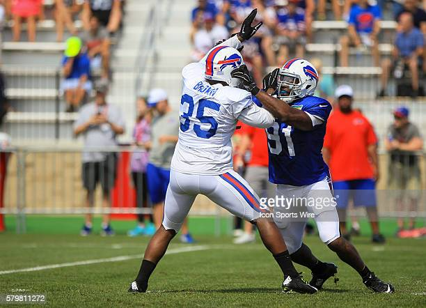 Buffalo Bills running back Bryce Brown battles Buffalo Bills defensive end Manny Lawson during the Buffalo Bills Training Camp at St John Fisher...