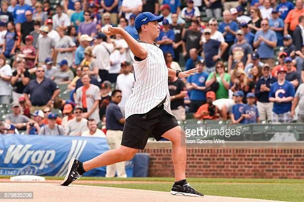 Chris Collins Head Coach of Northwestern Men's basketball program throws a ceremonial pitch prior to a MLB game between the Chicago Cubs and the San...