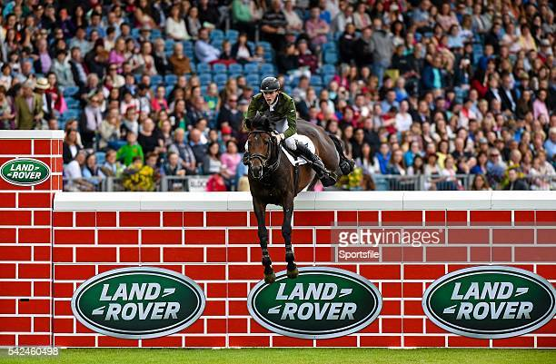 8 August 2015 Daniel Coyle competing on Fanadwest Rebel clearing the wall during the Land Rover Puissancein during the Discover Ireland Dublin Horse...