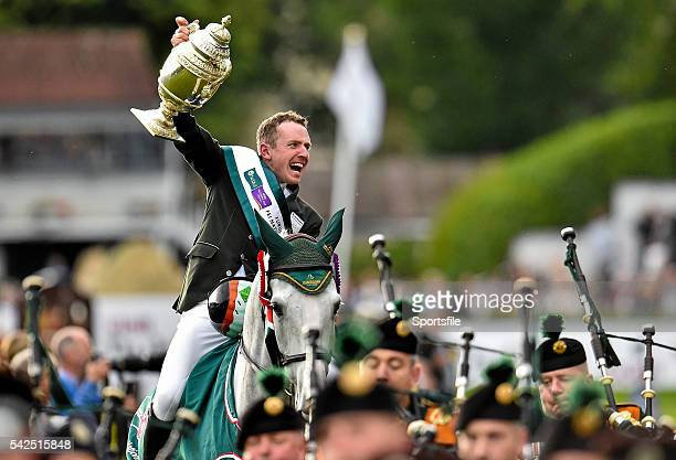 7 August 2015 Greg Patrick Broderick Ireland celebrates with the Aga Khan trophy after his team's victory in the Furusiyya FEI Nations Cup during the...