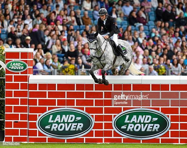 8 August 2015 Jason Higgins competing on Hadine Van'T Zorgvliet clearing the wall during the Land Rover Puissancein during the Discover Ireland...