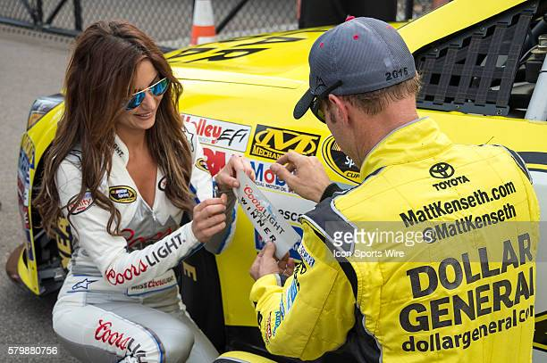 Matt Kenseth readies to apply the Coors Light Pole award sticker to his race car after winning the pole at Michigan International Speedway in...