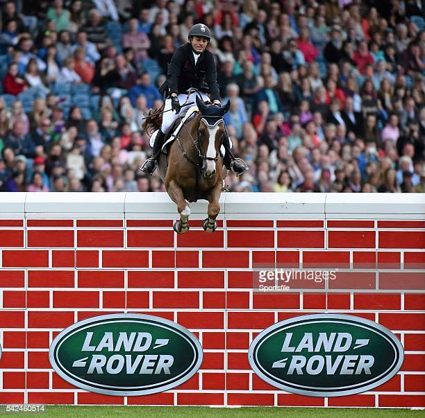 8 August 2015 Sameh El Dahan from Egypt competing on Seapatrick Cruise Cavalier clears the wall to win the Land Rover Puissancein at the Discover...