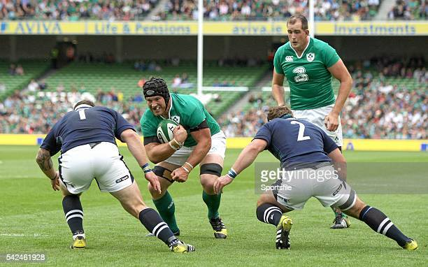 15 August 2015 Sean O'Brien Ireland is tackled by Ryan Grant left and Fraser Brown Scotland Rugby World Cup WarmUp Match Ireland v Scotland Aviva...