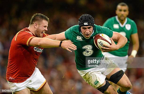 August 2015; Tommy O'Donnell, Ireland, holds off the tackle of Rob Evans, Wales. Rugby World Cup Warm-Up Match, Wales v Ireland, Millennium Stadium,...
