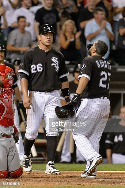 Chicago White Sox Designated hitter Avisail Garcia [6604] meets Chicago White Sox Catcher Dioner Navarro [3668] at the plate after Navarro hits a two...