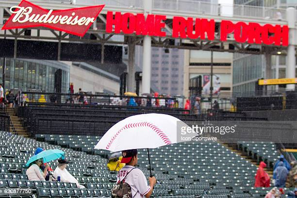 b51f244a430 Fans wait in the rain as the Major League Baseball game between the Los  Angeles Angels