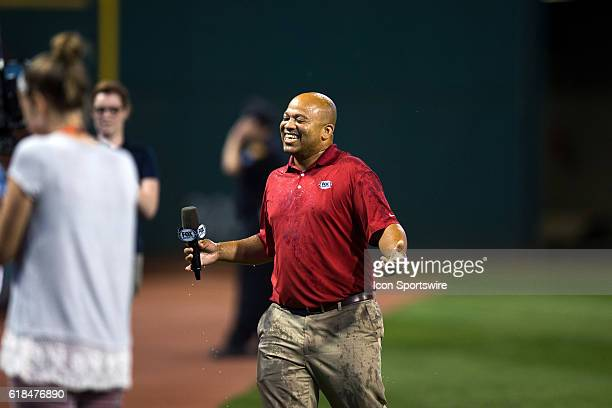 Fox Sports sideline field reporter Andre Knott is all wet after getting a water bucket dumped on his head while doing an interview after the Major...