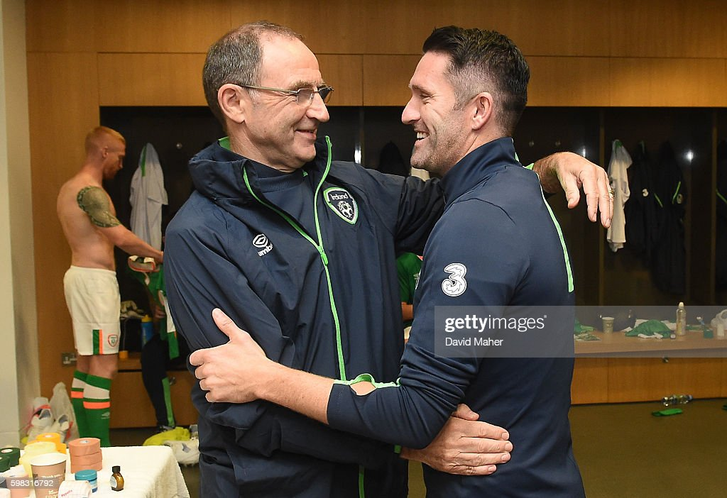 31 August 2016; Republic of Ireland manager Martin O'Neill, left, congratulates Robbie Keane in the dressing room following the Three International Friendly game between the Republic of Ireland and Oman at the Aviva Stadium in Lansdowne Road, Dublin. (Photo By David Maher/Sportsfile