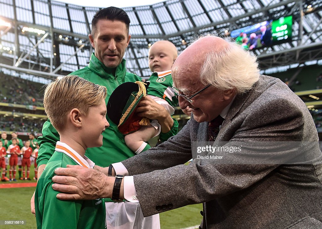 31 August 2016; The President of Ireland Michael D. Higgins greets Robert Keane, the son of Robbie Keane, during the Three International Friendly game between the Republic of Ireland and Oman at the Aviva Stadium in Lansdowne Road, Dublin. (Photo By David Maher/Sportsfile