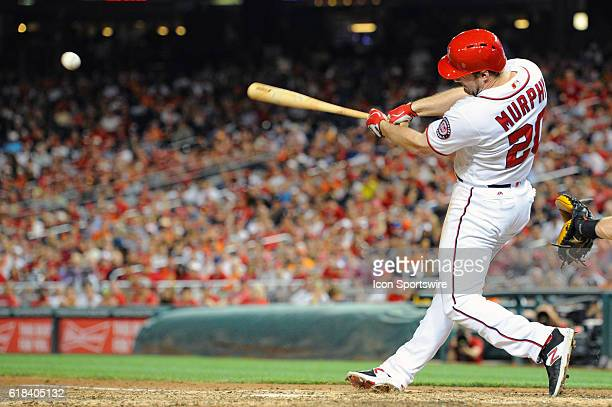Washington Nationals second baseman Daniel Murphy hits a grand slam against the Baltimore Orioles at Nationals Park in Washington DC where the...
