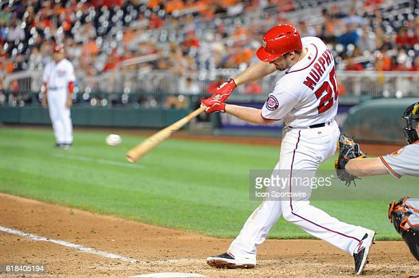 Washington Nationals second baseman Daniel Murphy hits a grand slam in the ninth inning against the Baltimore Orioles at Nationals Park in Washington...