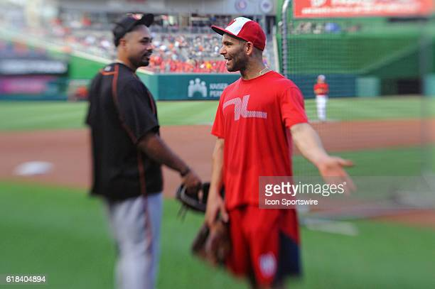 Washington Nationals shortstop Danny Espinosa talks with Baltimore Orioles designated hitter Pedro Alvarez prior to the game at Nationals Park in...
