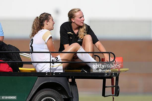 Wofford's Rachel Fenner is tended to by the team's trainer as she is carted off of the field with a gameending injury The Duke University Blue Devils...