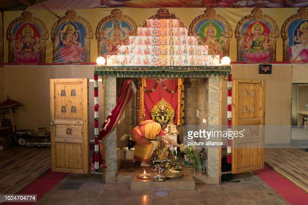 An altar is decorated by a member of the Hindu community One of the largest Hindu temples in Europe is being built on Berlin's Hasenheide a park in...