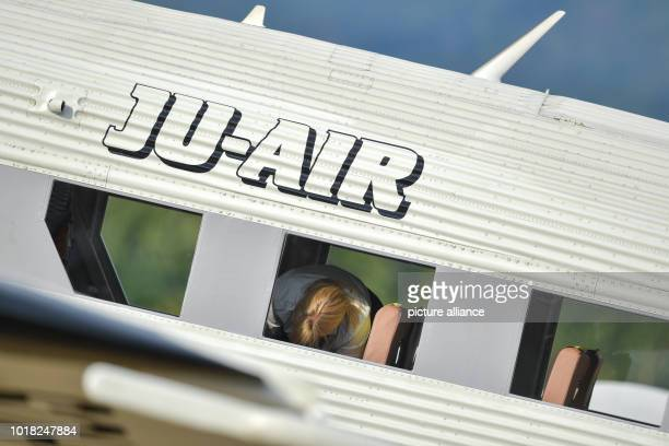 An employee is standing in the cabin of a Ju52 passenger aircraft of the airline JuAir after landing It is the airline's first flight after the crash...