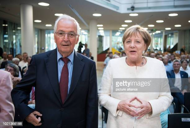 Angela Merkel German Chancellor and Chairwoman of the Christian Democratic Union and the former German Environment Minister Klaus Toepfer meet in the...
