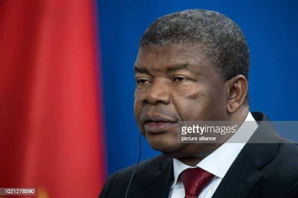João Lourenço President of the Republic of Angola speaks at a press conference with Chancellor Merkel after her meeting in the Federal Chancellery...