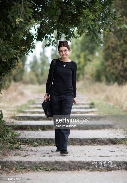 Justina Loos GermanPolish interpreter stands in a park in Prenzlauer Berg Without interpreters Berlin's police and courts would be helpless But the...