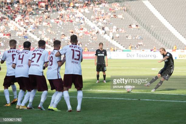 Soccer DFB Cup 1st round BFC Dynamo Berlin vs 1 FC Cologne in the Olympic Stadium Cologne's Marcel Risse scores a freekick through the BFC defensive...