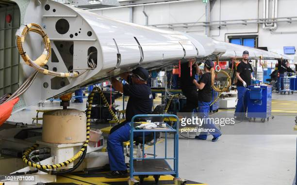 Airbus employees are working on the wing of an A350 at the Bremen plant while Bremen's Mayor Sieling visited the Airbus plant in Bremen on Thursday...