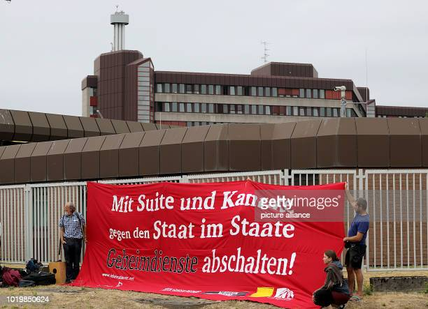 Musicians hold a banner with the inscription 'mit Suite und Kantate gegen den Staat im Staate Geheimdienste abschalten' in front of the Federal...