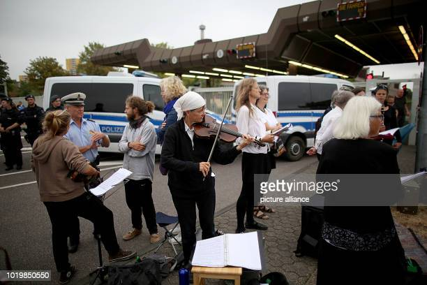 Musicians play at the Federal Office for the Protection of the Constitution The 60 or so musicians blocked the entrances to the Federal Office for...