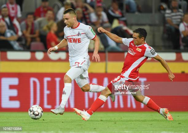 2nd Bundesliga 1st FC Cologne vs 1st FC Union Berlin 2nd matchday at the RheinEnergieStadion Cologne's Christian Clemens leads Unions Manuel...