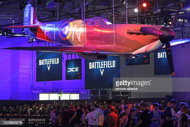 Visitors of Gamescom are waiting under an airplane at the Electronic Arts stand for the game 'Battlefield' For the tenth time the Computer...