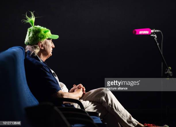 The comedian Otto Waalkes sitting in a cinema with a green cap The 70yearold is lending his voice to the green grouch for the animated film Der...