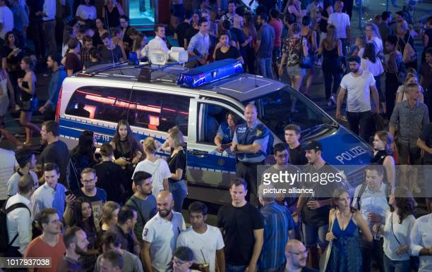A police car stands in the middle of the visitors of the red light district at the street festival in the station district Photo Boris Roessler/dpa