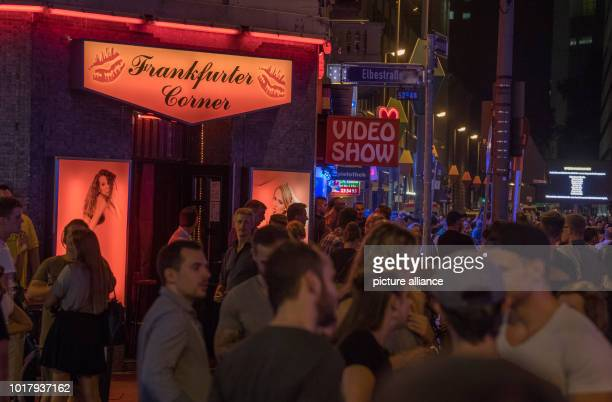 Visitors flock through the streets of the red light district at the street festival in the station district Photo Boris Roessler/dpa