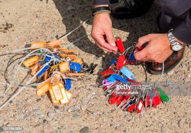 An employee of the city sorts keys for houses on the grounds of a former refugee shelter in the Jenfeld district The city of Hamburg offers 50 former...