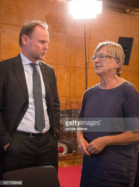 Andy Grote Senator of the Interior of Hamburg and Antje Moeller Green Civic Group discuss in the Great Hall in Hamburg City Hall before the last...