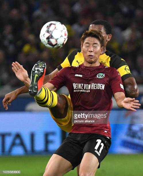 Soccer Bundesliga Matchday 2 Hannover 96 Borussia Dortmund in the HDI Arena Hanover's Takuma Asano and Dortmund's Manuel Akanji vie for the ball...