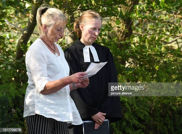 Pastor Tabea Roesler speaks next to Silke Bischoff's mother Karin R at the cemetery after the laying of the wreath at the grave of the Bishop who was...