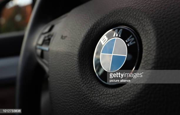 A BMW logo in the engine compartment of a BMW 525 fourcylinder diesel engine BMW is recalling 324000 cars in Europe due to a possible fire hazard...